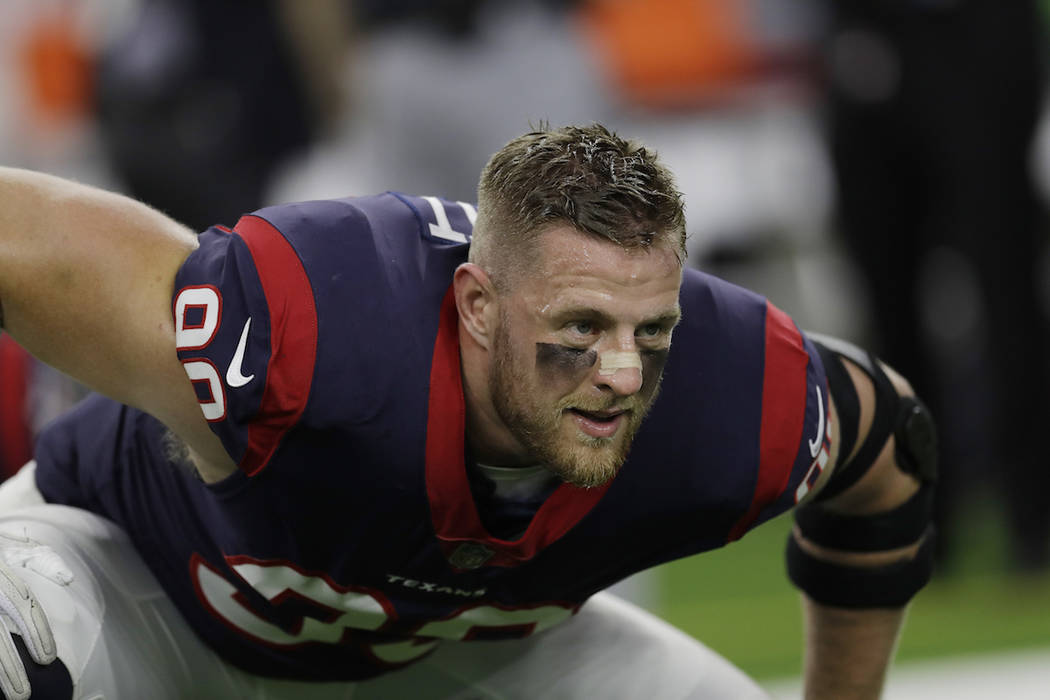 This Oct. 8, 2017 photo shows Houston Texans defensive end J.J. Watt (99) warming up before an NFL football game against the Kansas City Chiefs in Houston. Watt, along with Greg Olsen and Benjamin ...