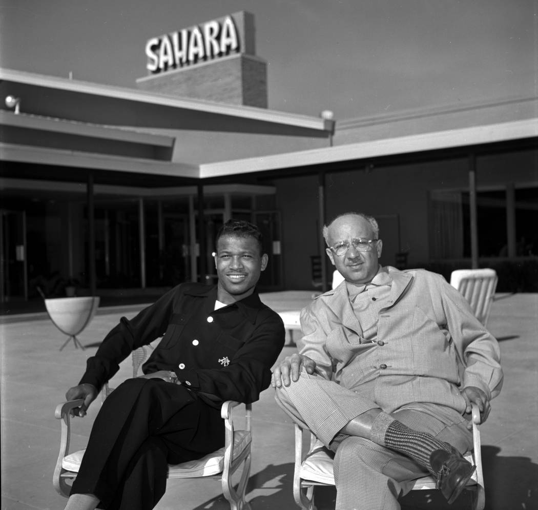 Sugar Ray Robinson and Milton Prell casino owner and developer sit at the Sahara hotel-casino in 1953. (Las Vegas Review-Journal File Photo)