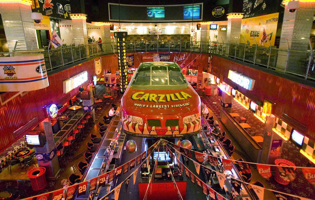 A scale NASCAR racing car is suspended above a bank of slot machines at The NASCAR Cafe inside the Sahara hotel-casino in 2007. (Las Vegas Review-Journal File Photo)