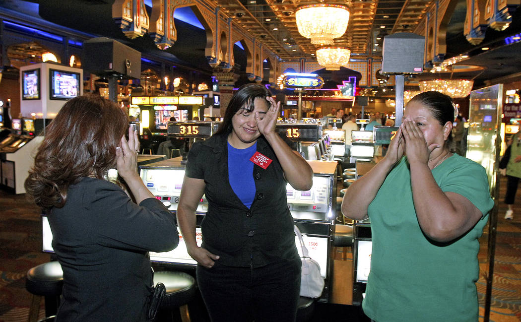 Sahara hotel-casino employees, from left, food and beverage manager Rebecca Santiago, server Barbara Nunez, and hostess Margarita Pinon, cry as they say goodbye on Monday, May 16, 2011, as the cas ...