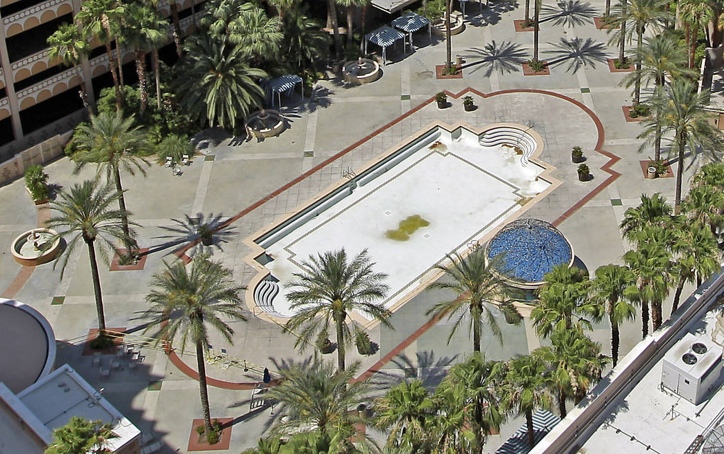 The Sahara hotel-casino pool sits empty in 2011, missing lounge chairs, most sold during the sale. (Las Vegas Review-Journal File Photo)