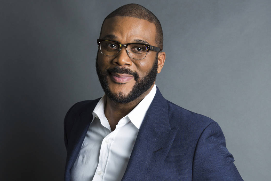 "Actor-filmmaker and author Tyler Perry poses for a portrait in New York to promote his book, ""Higher Is Waiting"" on Nov. 16, 2017. (Amy Sussman/Invision/AP, File)"