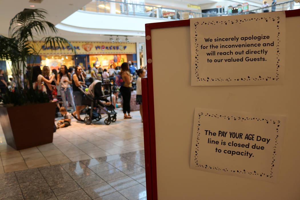 "A sign indicates that no more people may enter the line during Build-A-Bear's ""Pay Your Age"" promotion at Galleria Mall in Henderson on July 12, 2018. (Janna Karel Las Vegas Review-Journal)"