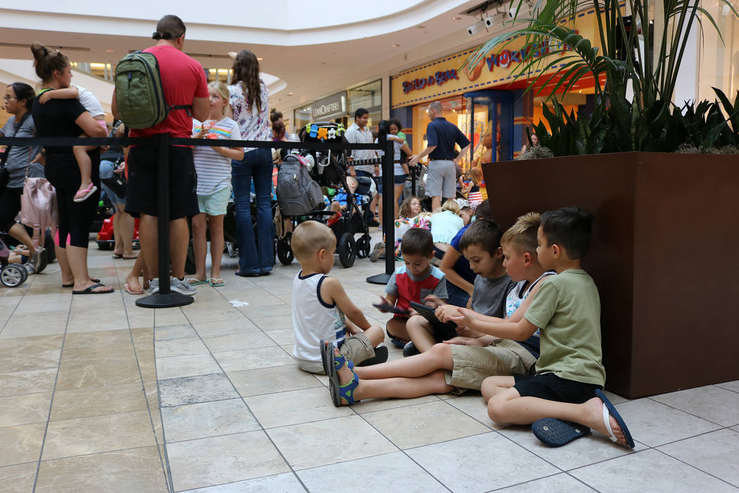 "Groups of children sat and played while waiting in line during Build-A-Bear's ""Pay Your Age"" promotion at Galleria Mall in Henderson on July 12, 2018. (Janna Karel Las Vegas Review-Journal)"