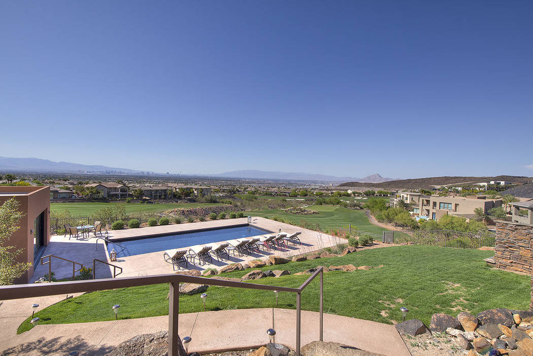 The large pool and pool house is located below the home. (Synergy/Sotheby's International Realty)