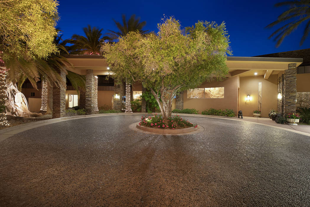 The home has a circular driveway. (Synergy/Sotheby's International Realty)