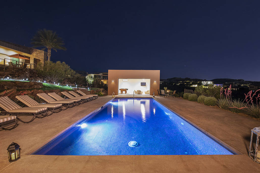 The pool house is at the end of the pool. (Synergy/Sotheby's International Realty)
