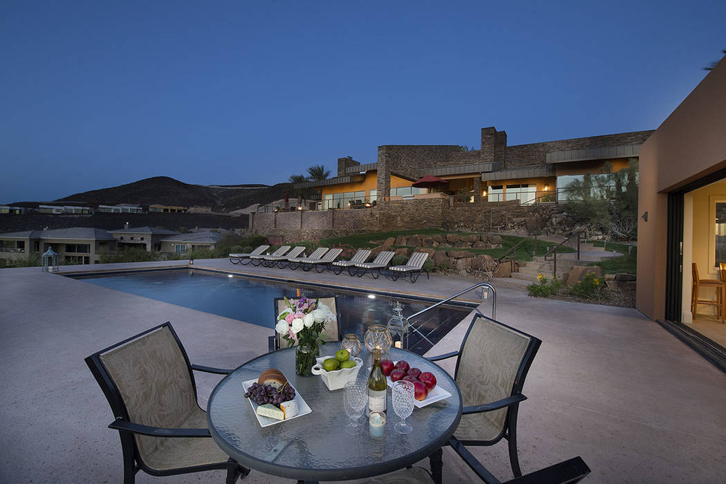 The pool area has lots of places for gathering. (Synergy/Sotheby's International Realty)