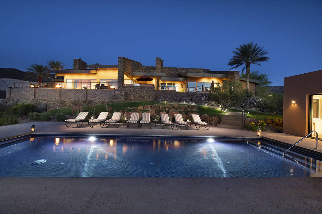 The home is above the pool area. (Synergy/Sotheby's International Realty)