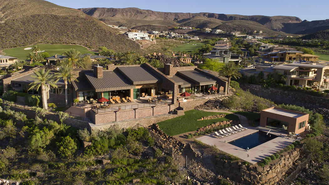 Land developer Rich MacDonald built this 10,000-square-foot home on 2.4 acres on a bluff above the fairways at DragonRidge Country Club. (Synergy/Sotheby's International Realty)