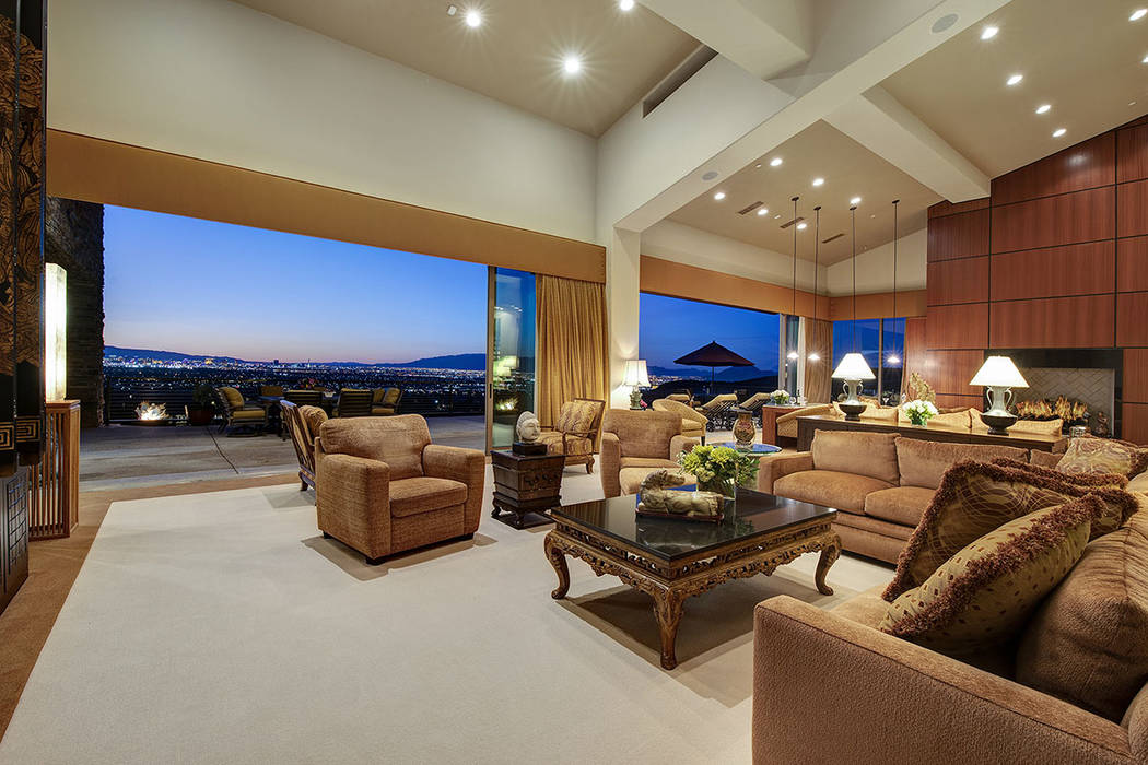 The large living room opens to the patio. (Synergy/Sotheby's International Realty)