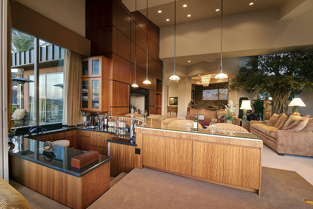 A sunken bar is adjacent to the great room. (Synergy/Sotheby's International Realty)