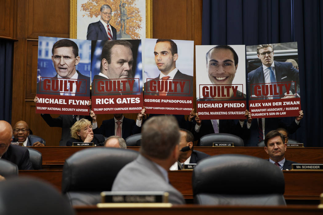 "Staff members hold up posters in a House Committees on the Judiciary and Oversight and Government Reform hearing on ""Oversight of FBI and DOJ Actions Surrounding the 2016 Election"" with ..."