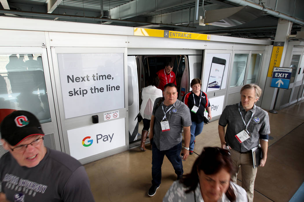 Passengers exit the Las Vegas Monorail Tuesday, March 20, 2018. The Las Vegas Monorail Co. hopes to extend the existing 3.9-mile SLS-to-MGM route an additional 1.14 miles to Mandalay Bay. K.M. Can ...