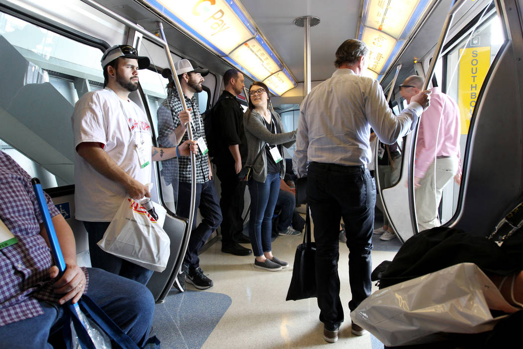 Passengers ride the Las Vegas Monorail Tuesday, March 20, 2018. The Las Vegas Monorail Co. hopes to extend the existing 3.9-mile SLS-to-MGM route an additional 1.14 miles to Mandalay Bay. K.M. Can ...