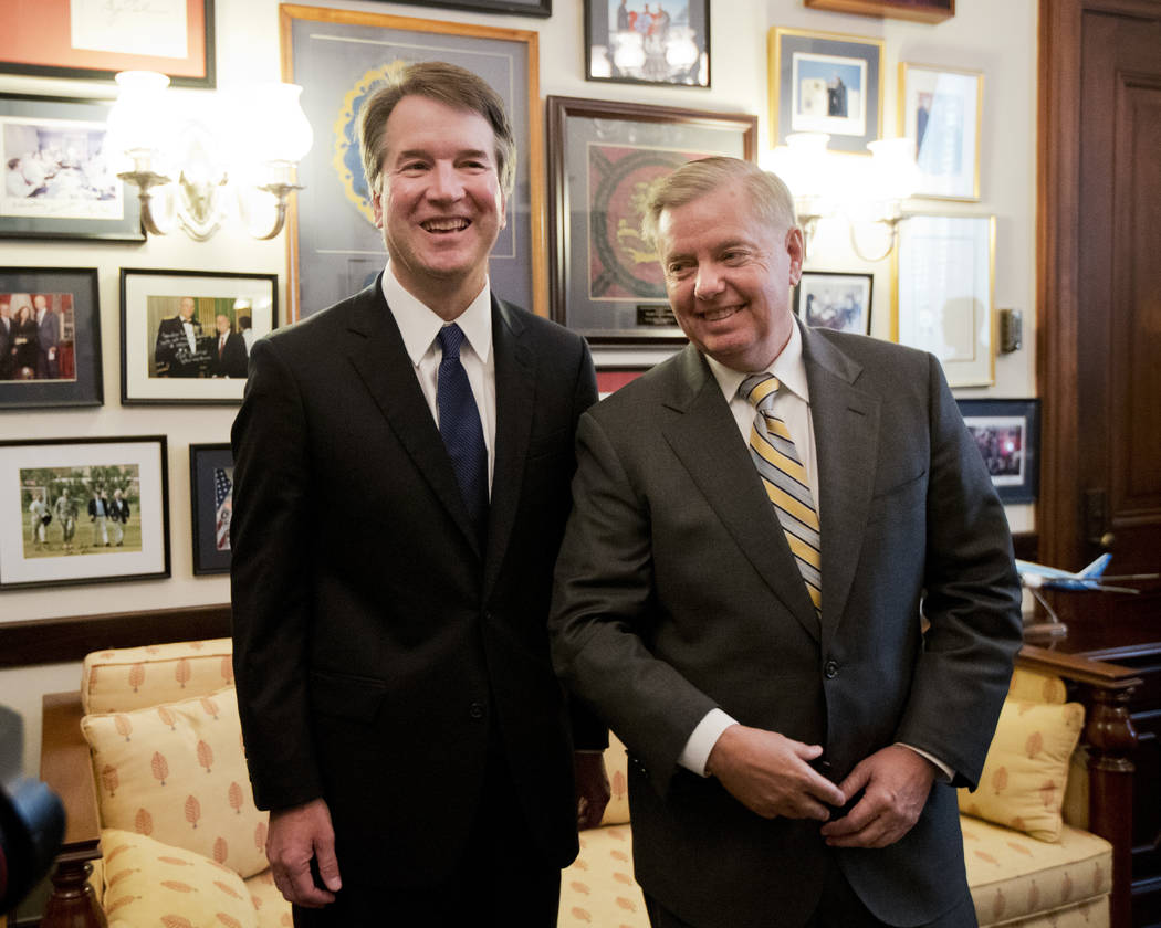 Supreme Court nominee Brett Kavanaugh, left, stands with Sen. Lindsey Graham, R-S.C. before the start of their meeting on Capitol Hill in Washington, Wednesday, July 11, 2018. (AP Photo/Manuel Bal ...