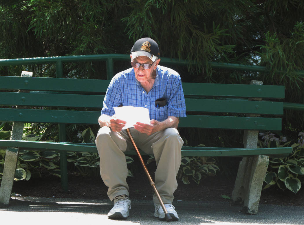Pete Martorana of Ocean Township, N.J., studies a betting sheet outside Monmouth Park racetrack in Oceanport, N.J., before placing his bets on baseball games on Thursday, July 12, 2018, the same d ...