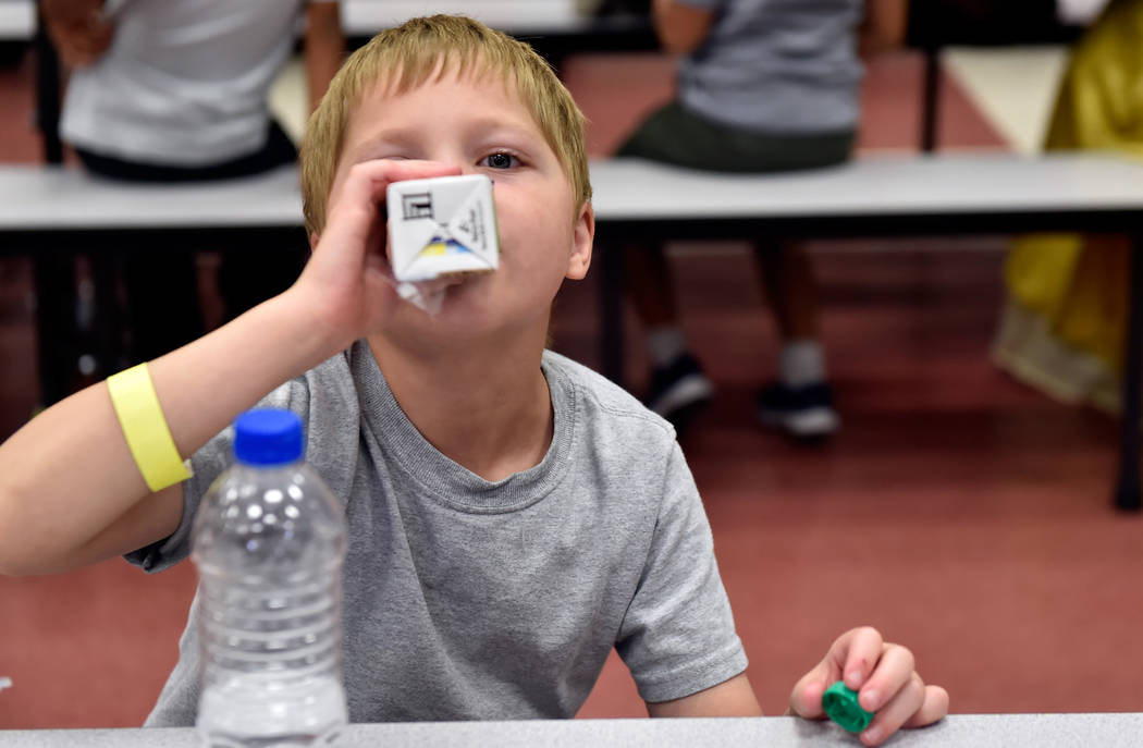 Raiden Flanders sips his soy milk during lunch at Red Rock Elementary School Tuesday, July 10, 2018, in Las Vegas. Clark County school's superintendent Jesus Jara stopped by the school during his ...