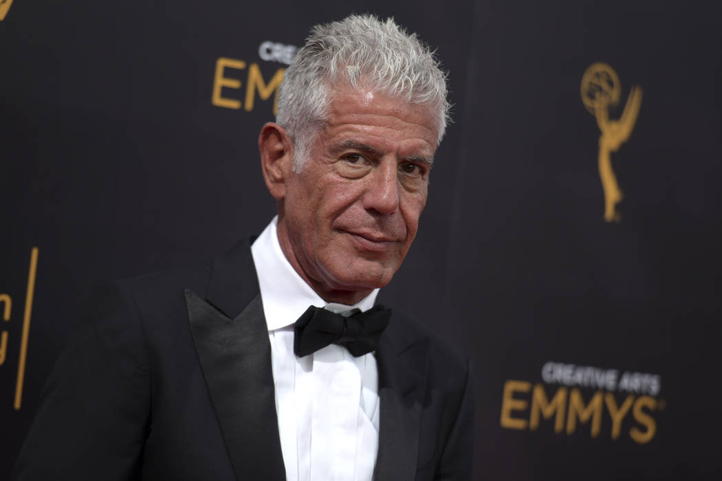 FILE - In this Sept. 11, 2016 file photo, Anthony Bourdain arrives at night two of the Creative Arts Emmy Awards in Los Angeles. Bourdain, who took his life in June, received several posthumous Em ...