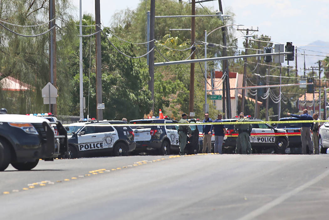 Members of the Metropolitan Police Department gather near Bruce and Ogden streets after an officer-involved shooting in Las Vegas, Wednesday, July 11, 2018. (Rachel Aston Las Vegas Review-Journal ...
