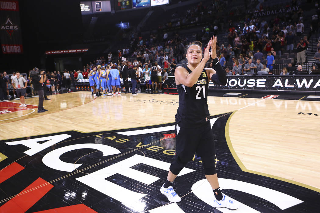 Las Vegas Aces guard Kayla McBride (21) celebrate's her team's defeat over Chicago Sky in a WNBA basketball game at Mandalay Bay Events Center in Las Vegas on Thursday, July 5, 2018. Chase Stevens ...