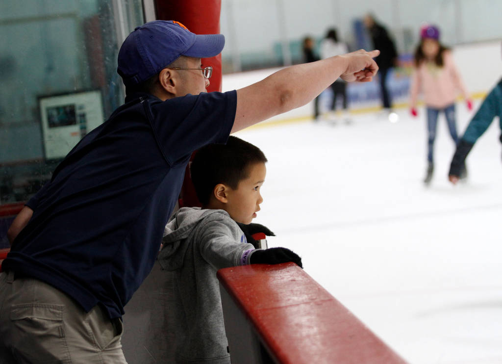 Jimmy Lam of North Las Vegas, left, talks with his son Nathan, 8, after Nathan's class at Las Vegas Ice Center in Las Vegas, Wednesday, July 18, 2018. Chitose Suzuki Las Vegas Review-Journal @chit ...