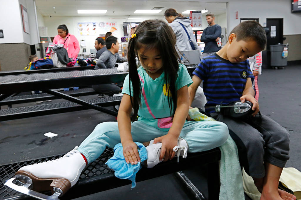 Erika Lam, 7, of North Las Vegas and her brother Nathan, 8, clean their skates after their class at Las Vegas Ice Center in Las Vegas, Wednesday, July 18, 2018. Chitose Suzuki Las Vegas Review-Jou ...