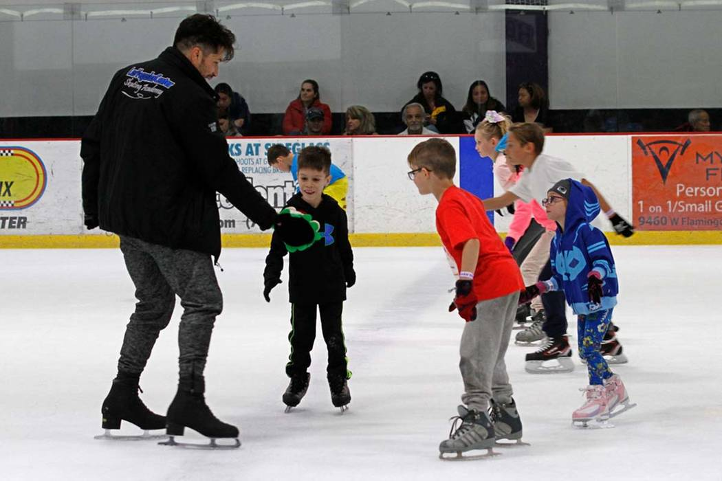 Skating coach Diego Hernandez, left, skates with his students after their class at Las Vegas Ice Center in Las Vegas, Wednesday, July 18, 2018. Chitose Suzuki Las Vegas Review-Journal @chitosephoto