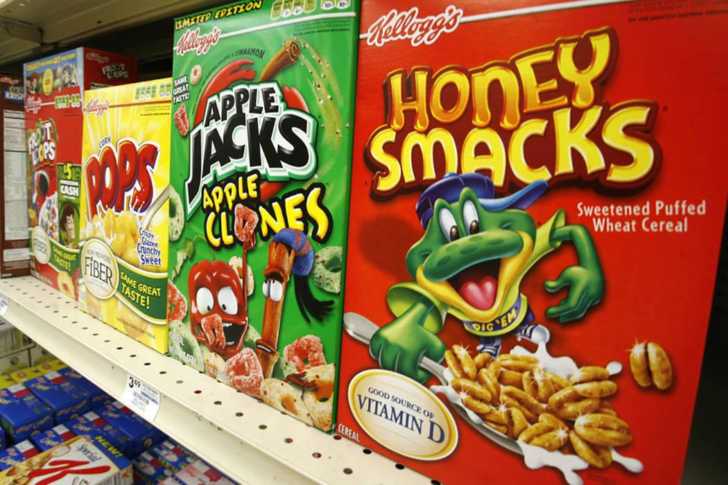 Boxes of Kellogg's Froot Loops, Corn Pops, Apple Jacks, and Honey Smacks sit on the shelf of a Mt. Lebanon, Pa. (AP Photo/Gene J. Puskar, File)