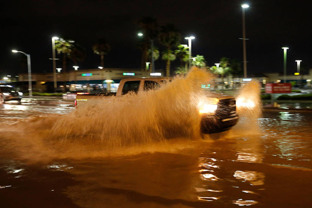 A truck plows through a flooded street at the intersection of Sahara and Decatur in Las Vegas on Saturday, July 14, 2018. (Chitose Suzuki/Las Vegas Review-Journal)