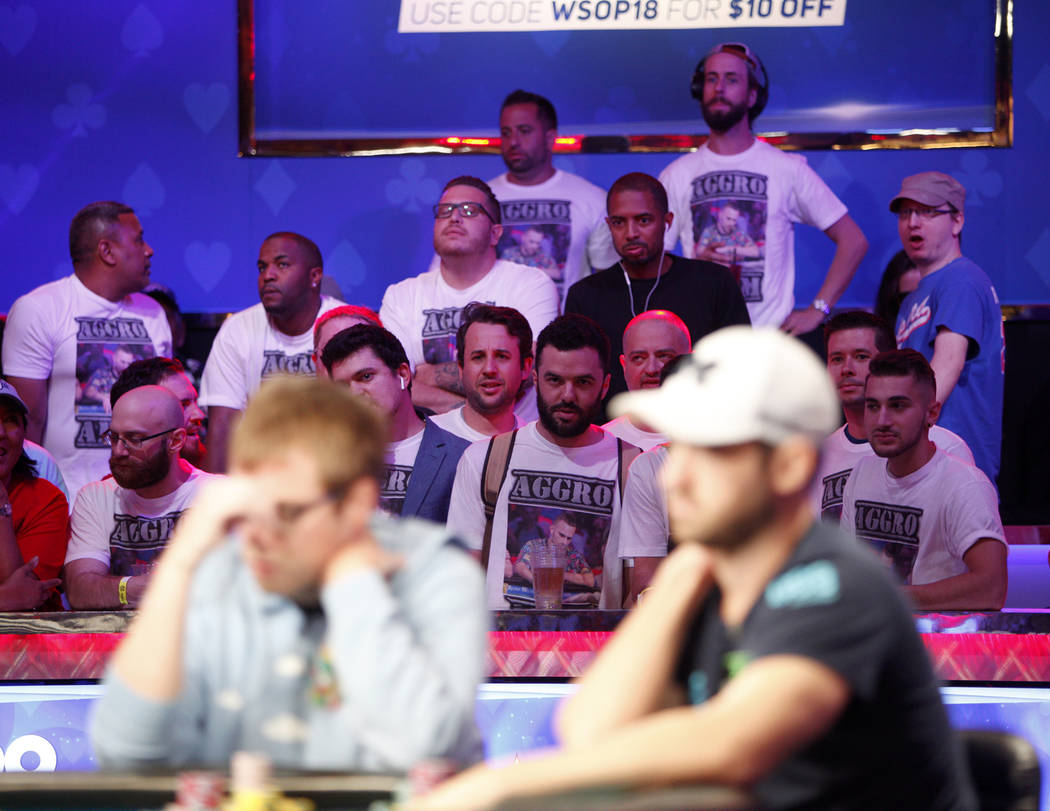 Fans of Aram Zobian look on during the eighth day of the World Series of Poker tournament at the Rio Convention Center in Las Vegas, Thursday, July 12, 2018. Artem Metalidi and Alexander Lynskey w ...