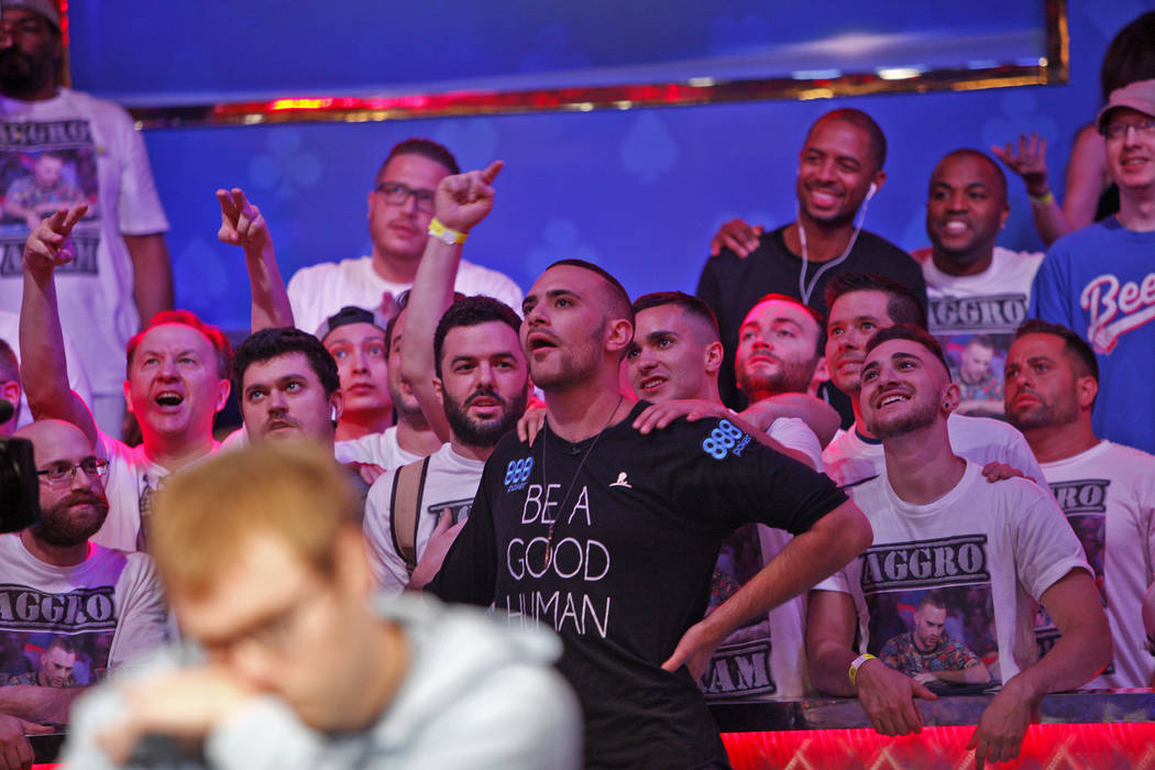 Supporters surround Aram Zobian as they wait for the play during the eighth day of the World Series of Poker tournament at the Rio Convention Center in Las Vegas, Thursday, July 12, 2018. Artem Me ...