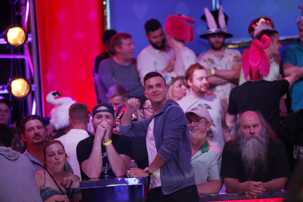Alexander Lynskey, his fans behind him, waits for the play to be called during the eighth day of the World Series of Poker tournament at the Rio Convention Center in Las Vegas, Thursday, July 12, ...