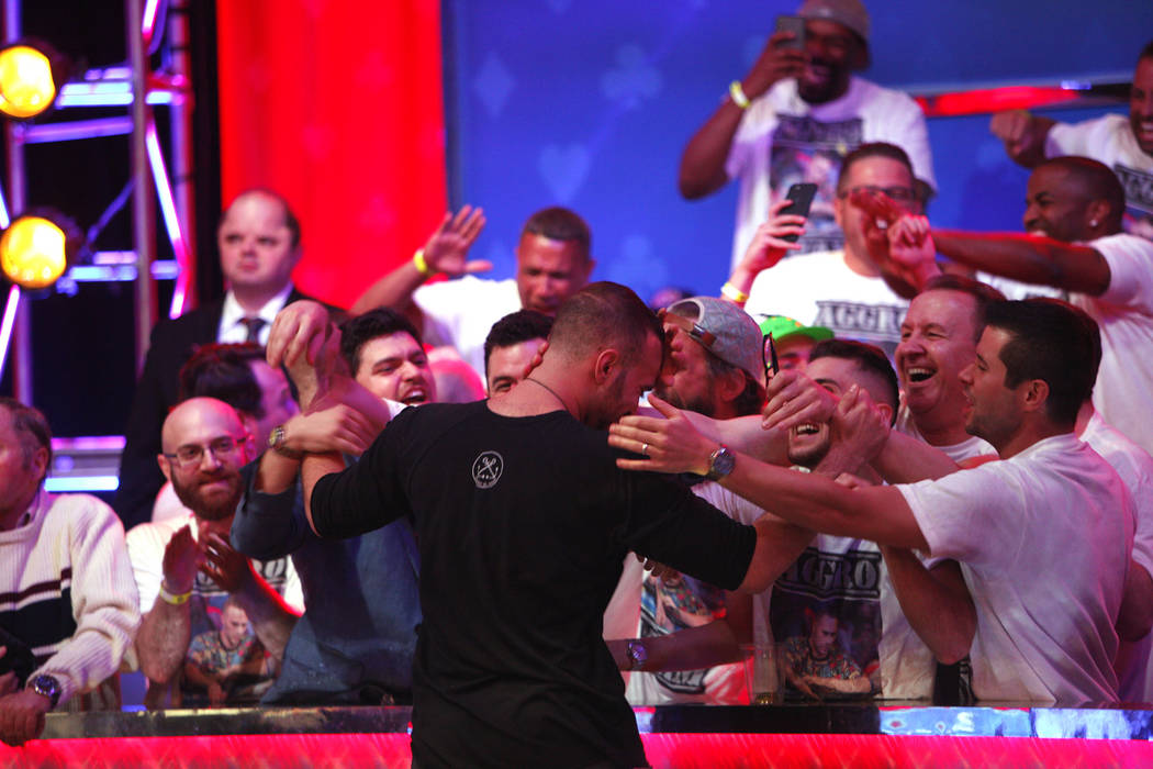 Aram Zobian and his fans react after a play is called during the eighth day of the World Series of Poker tournament at the Rio Convention Center in Las Vegas, Thursday, July 12, 2018. Rachel Aston ...