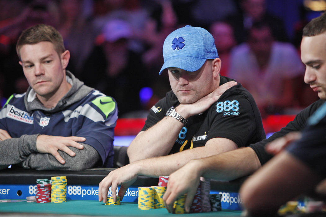 Tony Miles, left, and Nicolas Manion, right, on the eighth day of the World Series of Poker tournament at the Rio Convention Center in Las Vegas, Thursday, July 12, 2018. Artem Metalidi and Alexan ...