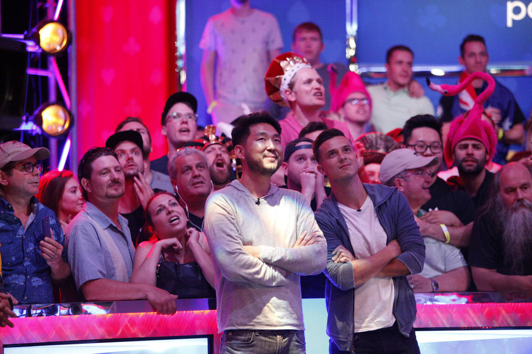 John Cynn, left, and Alexander Lynskey, right, wait for the play to be called during the eighth day of the World Series of Poker tournament at the Rio Convention Center in Las Vegas, Thursday, Jul ...