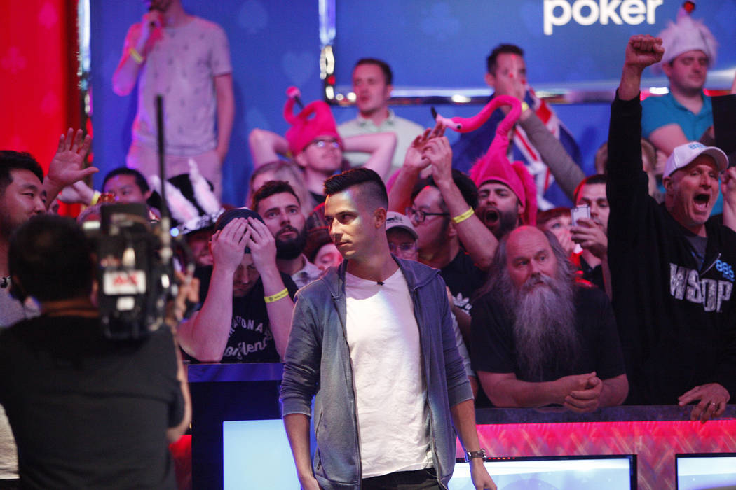 Alexander Lynskey, his fans behind him, react when the play pushes Lynskey out in seventh place during the eighth day of the World Series of Poker tournament at the Rio Convention Center in Las Ve ...