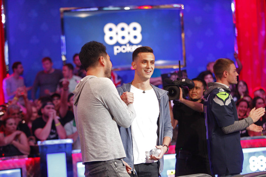 John Cynn shakes hands with Alexander Lynskey after the play eliminated Lynskey in seventh place during the eighth day of the World Series of Poker tournament at the Rio Convention Center in Las V ...