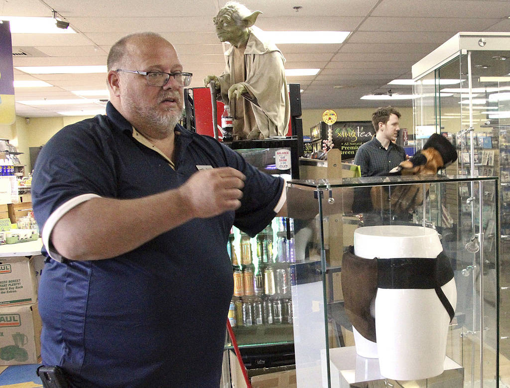 "In this May 2, 2018 file photo, Blockbuster Alaska General Manager Kevin Daymude moves a display case featuring the jockstrap worn by actor Russell Crowe in the 2005 movie ""Cinderella Man"" at a Bl ..."