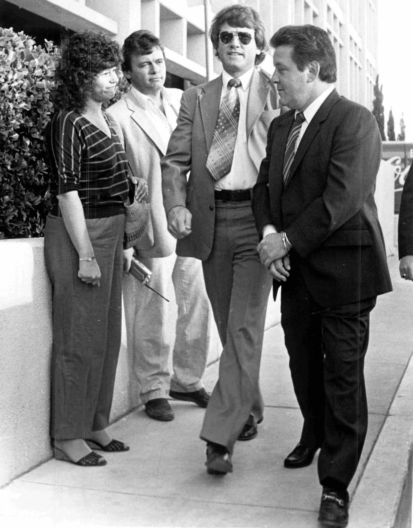 "Federal court reporter Jane Ann Morrison doesn't know what to say to mobster Anthony Spilotro in 1983 when he is doing the ""perp"" walk following his indictment. She is flanked by KLAS-TV ..."