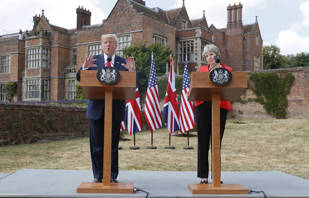 President Donald Trump with British Prime Minister Theresa May during their joint news conference at Chequers, in Buckinghamshire, England, Friday, July 13, 2018. (AP Photo/Pablo Martinez Monsivais)
