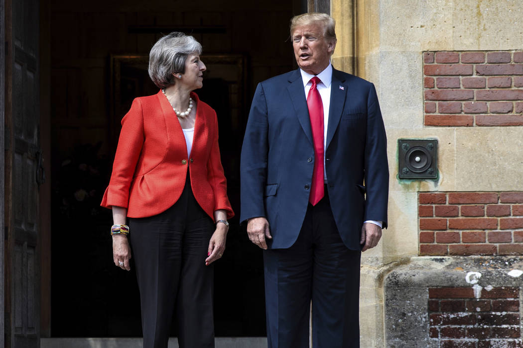 British Prime Minister Theresa May greets U.S President Donald Trump before their meeting at Chequers, in Buckinghamshire, England, Friday, July 13, 2018. (Jack Taylor/Pool Photo via AP)