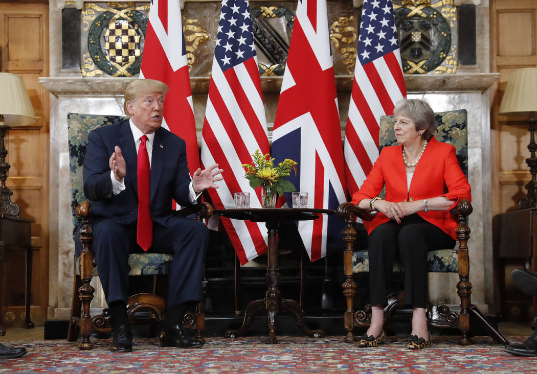 U.S. President Donald Trump, left, gestures while speaking during their meeting with with British Prime Minister Theresa May, right, at Chequers, in Buckinghamshire, England, Friday, July 13, 2018 ...