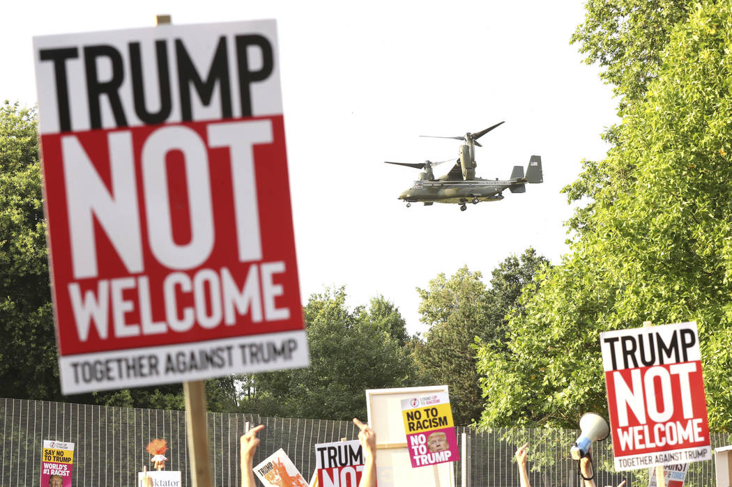 A helicopter leaves the grounds of the US ambassador residence in Regent's Park, London, while demonstrators protest against the visit of US President Donald Trump Thursday July 12, 2018. (Gareth ...