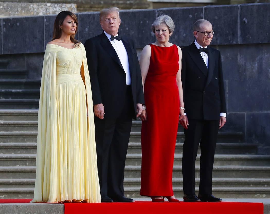 From left, first lady Melania Trump, President Donald Trump, British Prime Minister Theresa May, and her husband Philip May, watch the arrival ceremony at Blenheim Palace, Oxfordshire, Thursday, J ...