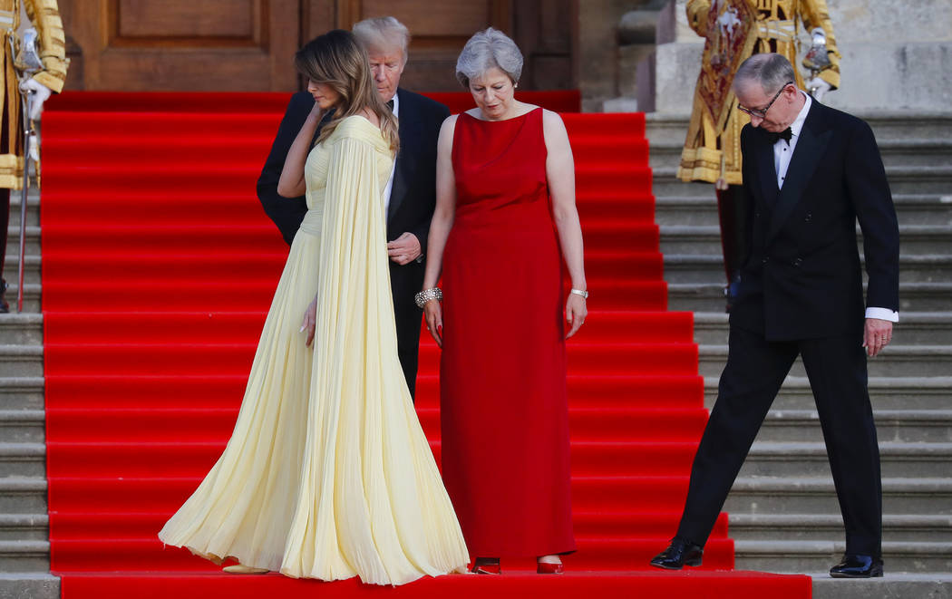 First lady Melania Trump, left, walks past President Donald Trump, British Prime Minister Theresa May, and May's husband Philip May, during the arrival ceremony at Blenheim Palace, Oxfordshire, Th ...