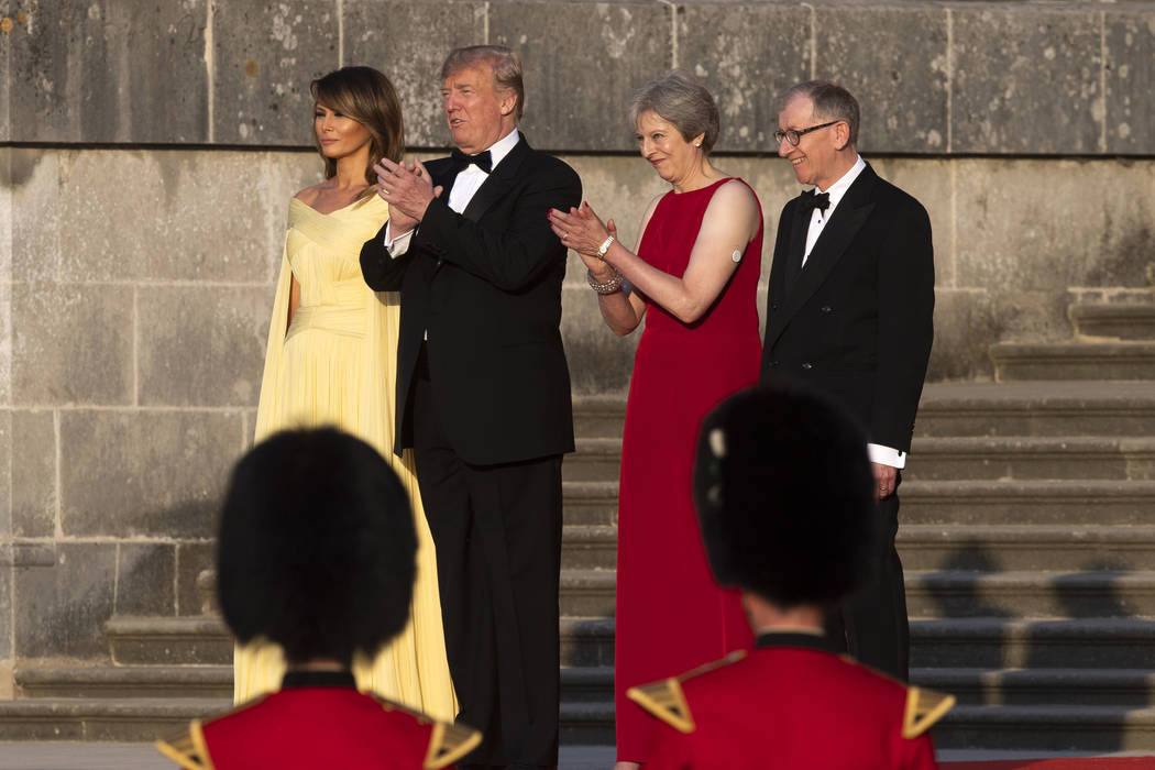From left, first lady Melania Trump, President Donald Trump, British Prime Minister Theresa May, and her husband Philip May, watch the arrival ceremony at Blenheim Palace, in Blenheim, England, Th ...