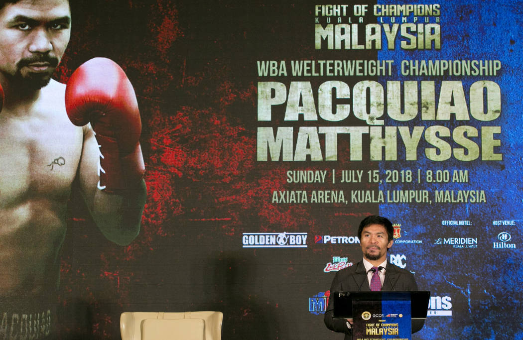 Philippine Senator and boxing hero Manny Pacquiao speaks during a press conference with Argentine WBA welterweight champion Lucas Matthysse in Kuala Lumpur, Malaysia, Thursday, July 12, 2018. Matt ...