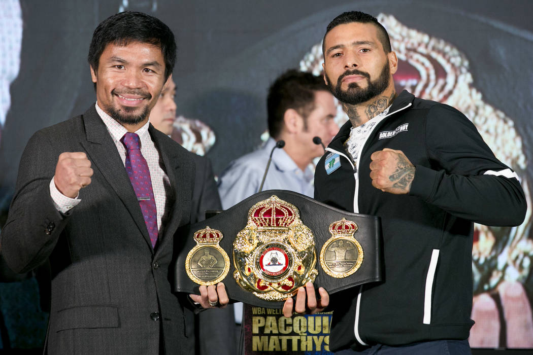 Philippine senator and boxing hero Manny Pacquiao, left, poses with Argentine WBA welterweight champion Lucas Matthysse during a press conference, in Kuala Lumpur, Malaysia, Thursday, July 12, 201 ...