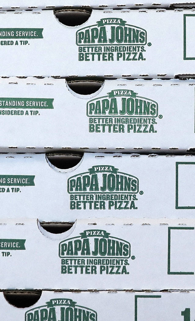 Pizza boxes stacked at a Papa John's pizza store in Quincy, Mass. on Dec. 21, 2017. (AP Photo/Charles Krupa, File)